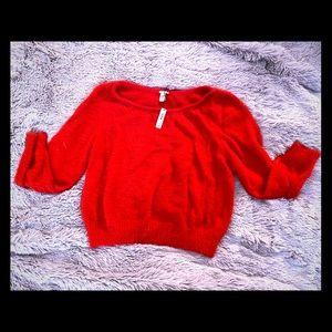 Victoria's Secret red sweater.